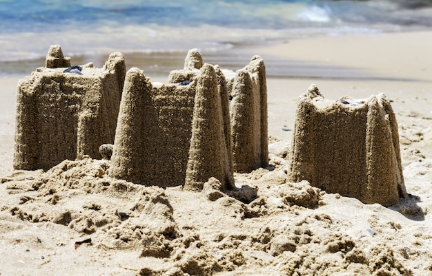 Sandcastles on the beach, vacation concept, toned.
