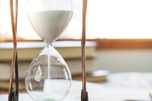 Sandglass on wooden table