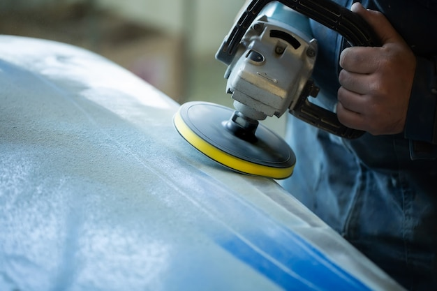 Sanding polishing of the bumper on the car at a hundred close-up