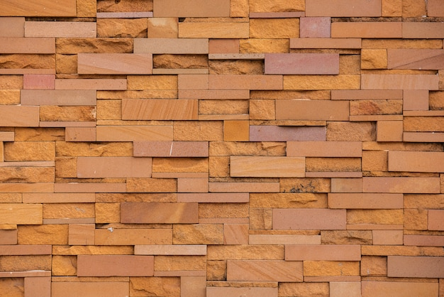 Sandstone bricks seamless of wall. pattern continuous replication for texture and background