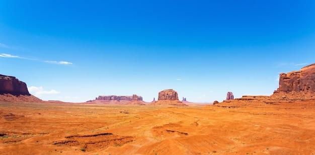 Sandstone mountains in desert of monument valley