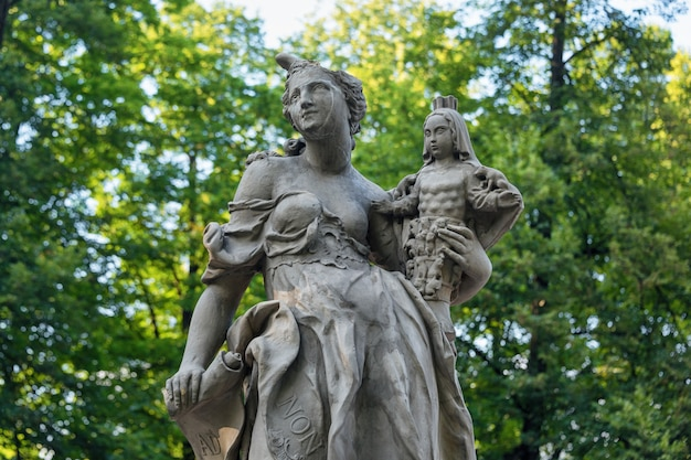 Sandstone statues in the saxon garden, warsaw, poland, made before 1745 by anonymous warsaw sculptor under the direction of johann georg plersch, statues of greek mythical muses.