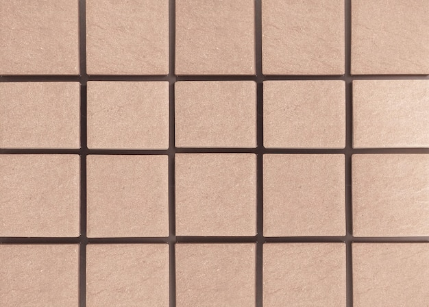 The sandstone wall is a square wall arranged in a row. background.