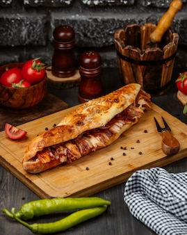 Sandwich in baguette with stuffing.