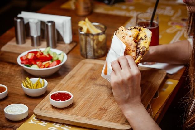 Sandwich in pita bread on wooden board