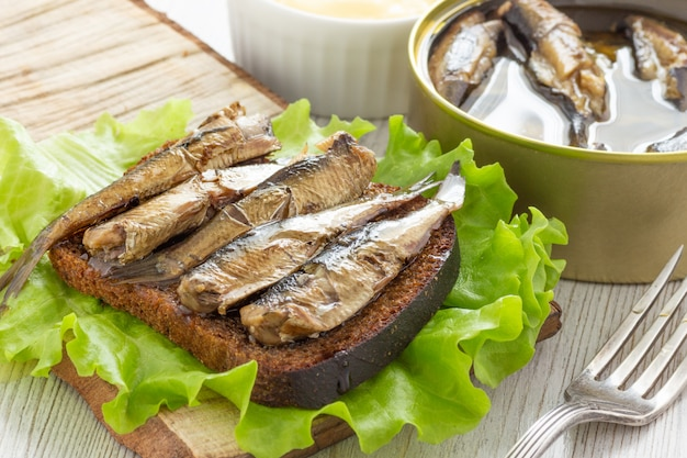 Sandwich with bread and canned sprats
