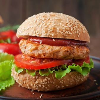 Sandwich with chicken burger, tomatoes and lettuce