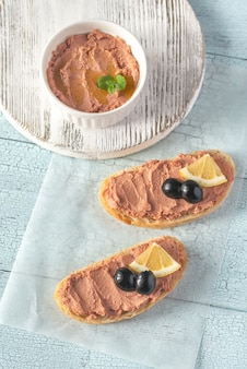 Sandwich with chicken liver pate and black olives
