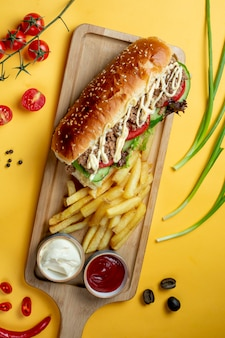 Sandwich with chopped meat and side fries _