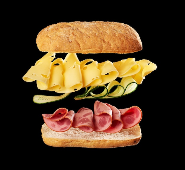 Sandwich with ciabatta bun, thin slices of sausage and edam cheese