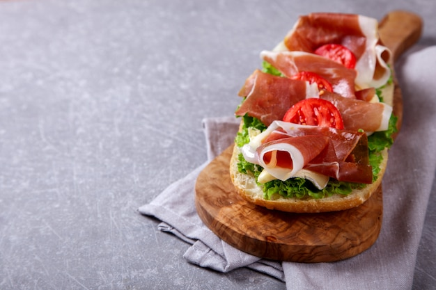 Sandwich with ciabatta, prosciutto