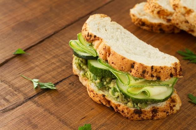 Sandwich with cucumber on desk