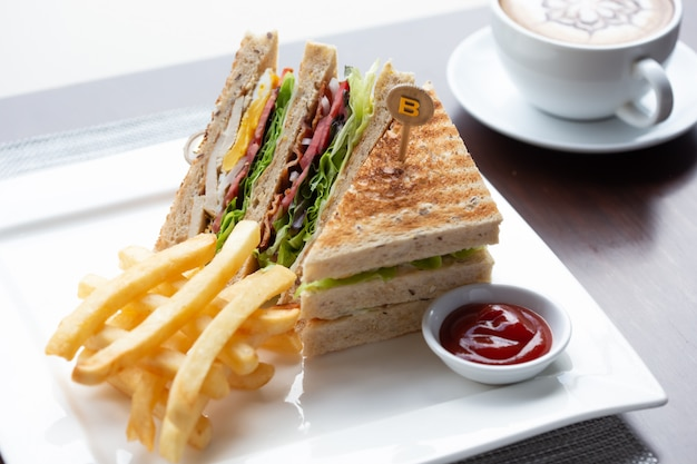 Sandwich with french fries and tomato sauce