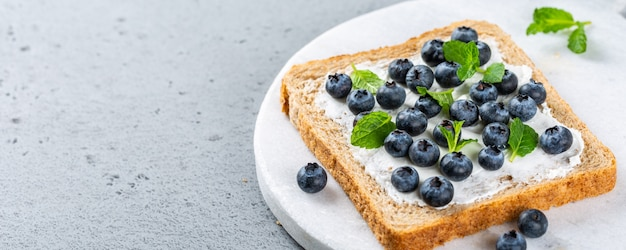 Sandwich with goat cheese and blueberries