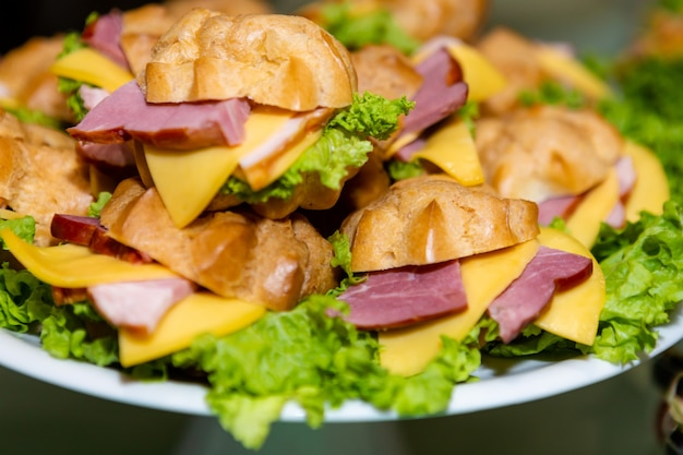 Sandwich with ham, lettuce and cheese.