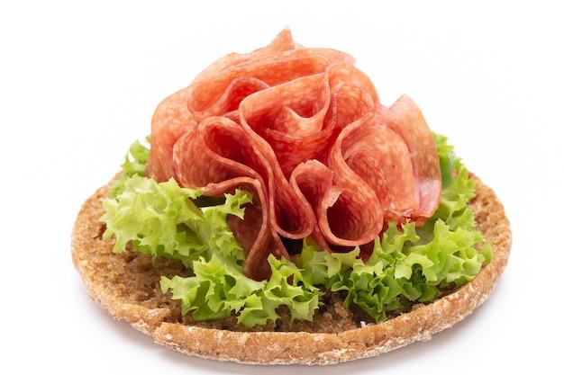 Sandwich with ham sausage on white background.