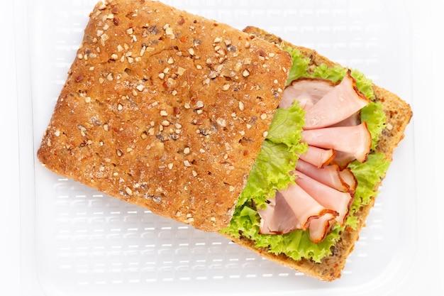 Sandwich with ham sausage on white background