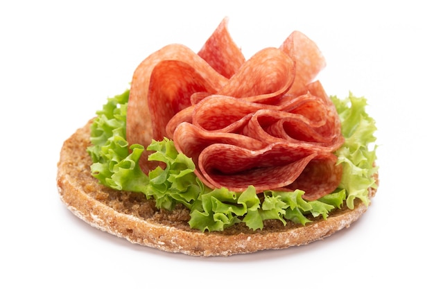 Sandwich with ham sausage on white space.