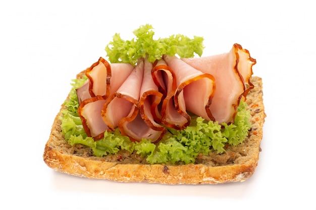Sandwich with ham sausage on white.