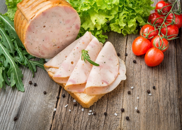 Sandwich with ham and vegetables