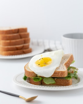 Sandwich with lettuce and fried egg