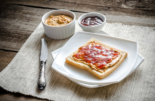 Sandwich with peanut butter and strawberry jelly