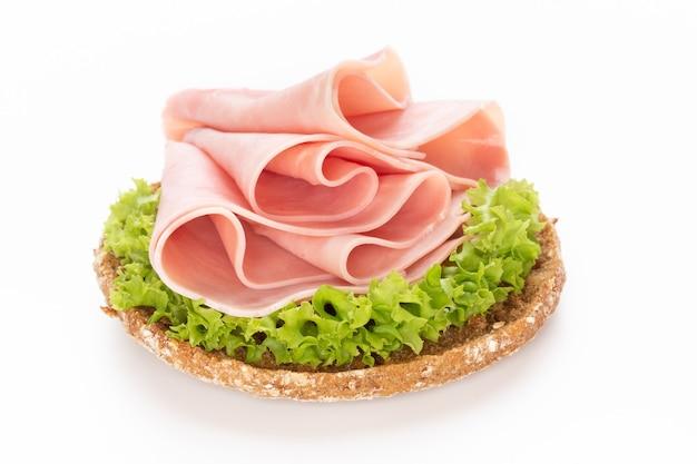 Sandwich with pork ham on white background.