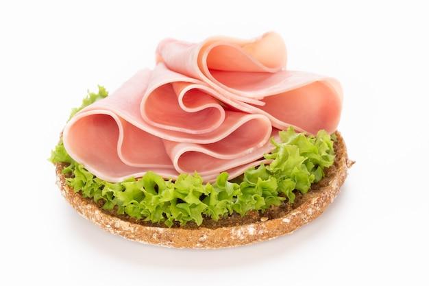 Sandwich with pork ham on white.