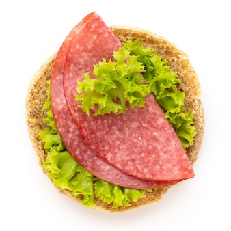 Sandwich with salami sausage on white background.