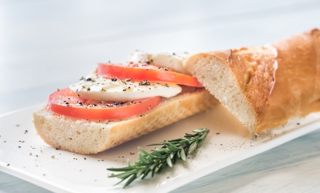 Sandwich with sliced fresh tomatoes and mozzarella
