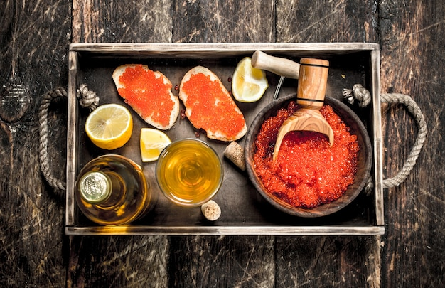 Sandwiches of caviar with white wine. on wooden background.