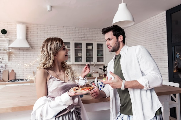 Sandwiches. cute long-haired young woman with nice makeup holding a plate with sandwiches