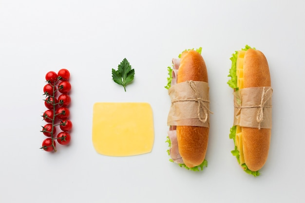 Sandwiches and ingredients flat lay