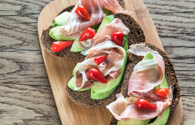 Sandwiches with avocado and italian ham