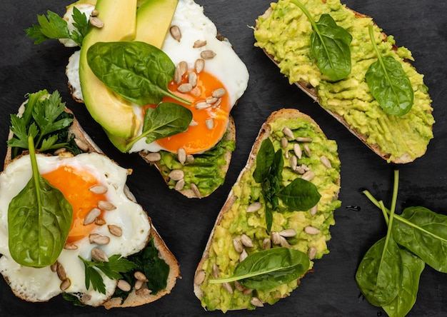 Sandwiches with avocado, spinach and fried eggs