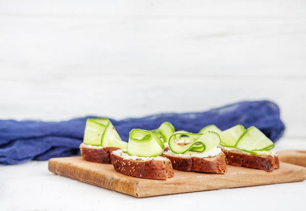 Sandwiches with cheese and cucumber. the concept of food and veg