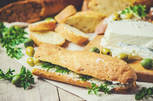 Sandwiches with cheese and olives. selective focus.