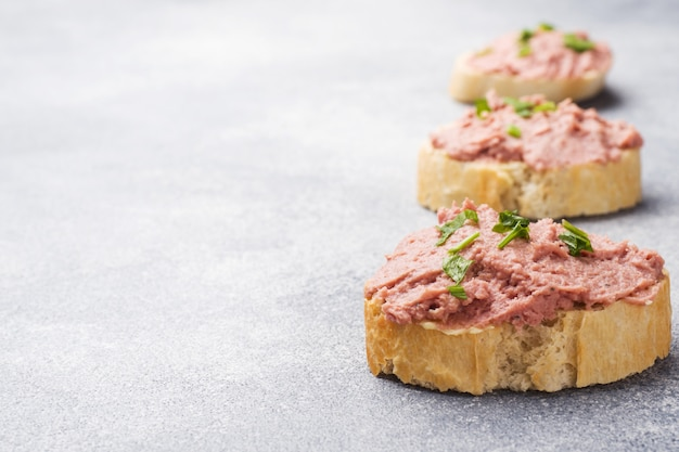 Sandwiches with chicken pate and butter on the table.