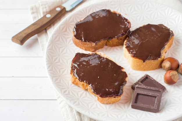 Sandwiches with chocolate hazelnut spread on the plate.
