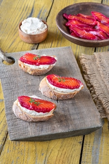 Sandwiches with cream cheese and beetroot cured salmon