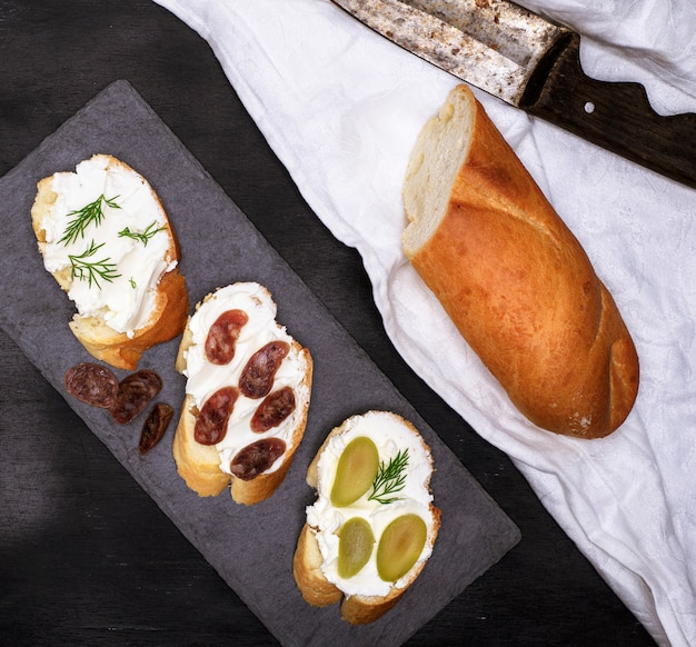 Sandwiches with cream cheese on black