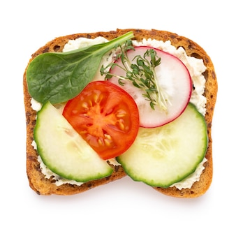 Sandwiches with cream cheese, vegetables and salami. sandwiches with cucumber, radish, tomatoes, salami on a white background, top view. flat lay.