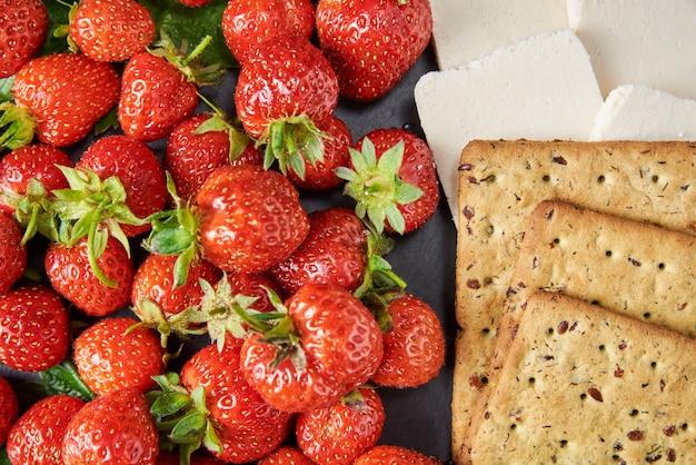 Sandwiches with fresh berries on a dark background