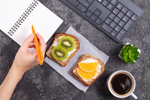 Sandwiches with fruits and cream cheese with a coffee