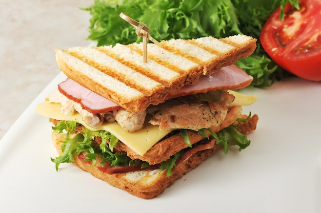 Sandwiches with lettuce, ham, cheese, chicken breast