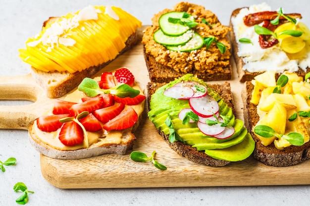 Sandwiches with mango, strawberry, tofu pate, avocado, potatoes and ricotta