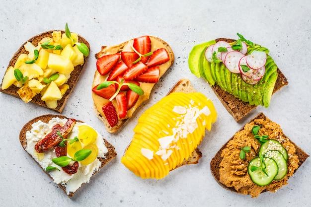 Sandwiches with mango, strawberry, tofu pate, avocado, potatoes