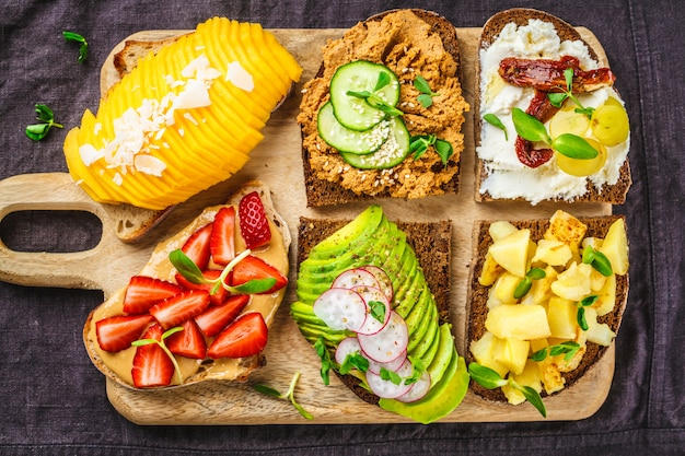 Sandwiches with mango, strawberry, tofu pate, avocado, potatoes