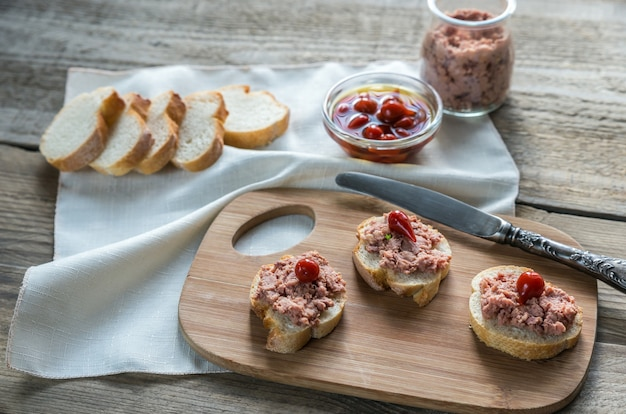 Sandwiches with pate on the wooden board