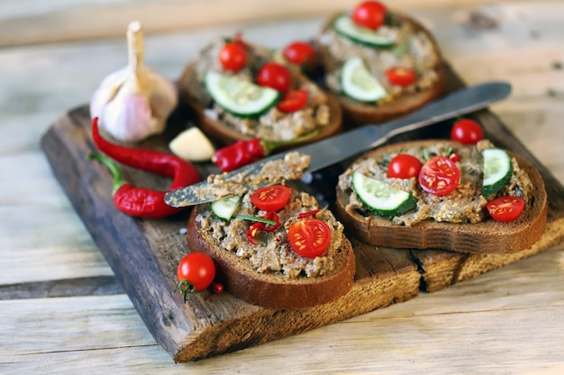 Sandwiches with pate on a wooden board